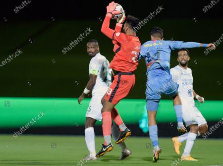 Al-Ahli's goalkeeper Mohammed Al-Owais (2-L) in action against Al-Batin's Saleh Al Abbas (2-R) during the Saudi Professional League soccer match between Al-Ahli and Al-Batin at King Abdullah Sport City Stadium, 30 kilometers north of Jeddah, Saudi Arabia, 31 January 2021.