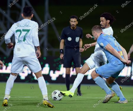 Al-Ahli's player Salman Al-Muwashar (R-back) in action against Al-Batin's Xandro Schenk (R-front) during the Saudi Professional League soccer match between Al-Ahli and Al-Batin at King Abdullah Sport City Stadium, 30 kilometers north of Jeddah, Saudi Arabia, 31 January 2021.
