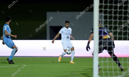 Al-Ahli's player Hussain Al Moqahwi (C) in action against Al-Batin's goalkeeper Martin Campana (R) and Renato Chaves (L) during the Saudi Professional League soccer match between Al-Ahli and Al-Batin at King Abdullah Sport City Stadium, 30 kilometers north of Jeddah, Saudi Arabia, 31 January 2021.