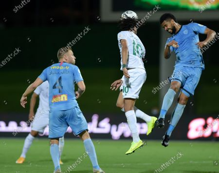 Al-Ahli's player Salman Al-Muwashar (C) in action against Al-Batin's Xandro Schenk (L) and Renato Chaves (R) during the Saudi Professional League soccer match between Al-Ahli and Al-Batin at King Abdullah Sport City Stadium, 30 kilometers north of Jeddah, Saudi Arabia, 31 January 2021.