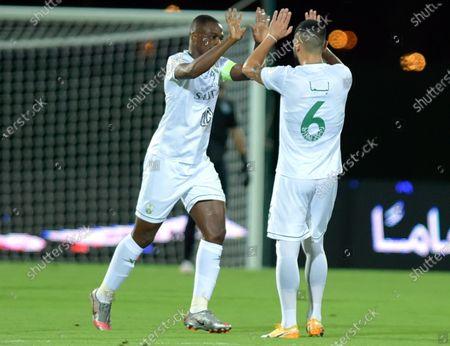 Al-Ahli's player Motaz Hawsawi (L) celebrates with teammate after scoring a goal during the Saudi Professional League soccer match between Al-Ahli and Al-Batin at King Abdullah Sport City Stadium, 30 kilometers north of Jeddah, Saudi Arabia, 31 January 2021.