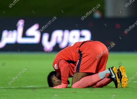 Al-Ahli's goalkeeper Mohammed Al-Owais kneels in celebration after his teammate scored a goal during the Saudi Professional League soccer match between Al-Ahli and Al-Batin at King Abdullah Sport City Stadium, 30 kilometers north of Jeddah, Saudi Arabia, 31 January 2021.