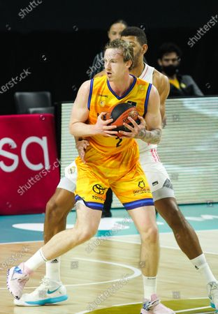 Stock Photo of Olek Balcerowski of Herbalife Gran Canaria and Walter Samuel Tavares da Veiga of Real Madrid in action during the Liga ACB basketball match played between Real Madrid and Herbalife Gran Canaria at WiZink Center stadium on January 31, 2021 in Madrid, Spain.