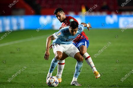 RC Celta de Vigo player Jeison Murillo and Granada CF player Fede Vico are seen in action during the La Liga Santander  match between Granada CF and RC Celta de Vigo at Nuevo Los Carmenes Stadium in Granada. (Final score: Granada CF 0:0 RC Celta de Vigo)
