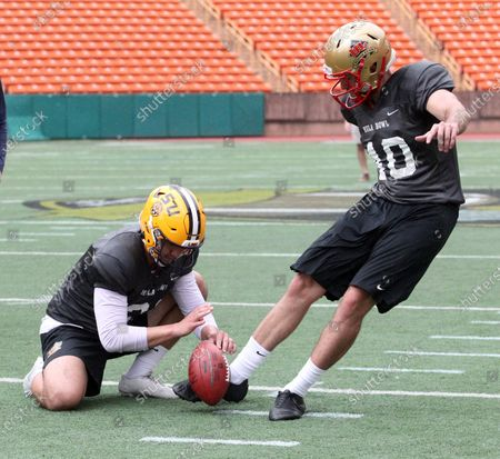 Stock Picture of LSU Tigers punter Zach Von Rosenberg #31 holds for Laval Rouge et Or (Canada) kicker David Cote #40 during a practice session prior to the Hula Bowl at Aloha Stadium in Honolulu , HI - Michael Sullivan/CSM