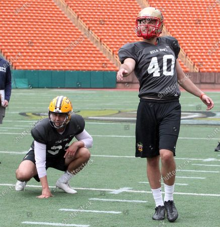 Stock Image of LSU Tigers punter Zach Von Rosenberg #31 holds for Laval Rouge et Or (Canada) kicker David Cote #40 during a practice session prior to the Hula Bowl at Aloha Stadium in Honolulu , HI - Michael Sullivan/CSM