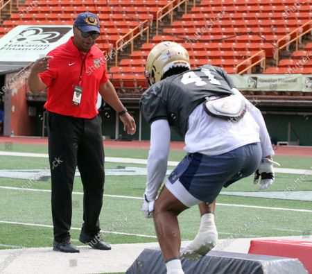 Boston College Eagles linebacker Max Richardson #41 gets pointers from coach Mike Singletary during a practice session prior to the Hula Bowl at Aloha Stadium in Honolulu , HI - Michael Sullivan/CSM