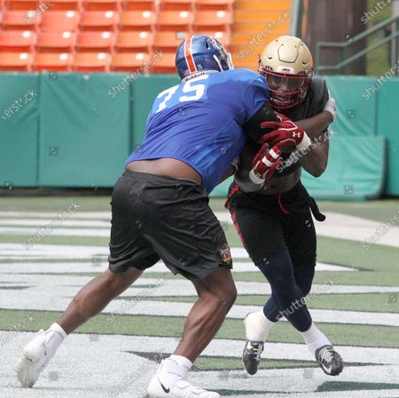 Savannah State Tigers offensive lineman Michael Johnson #75 and Boston College Eagles outside linebaker Max Roberts #44 during a practice session prior to the Hula Bowl at Aloha Stadium in Honolulu , HI - Michael Sullivan/CSM