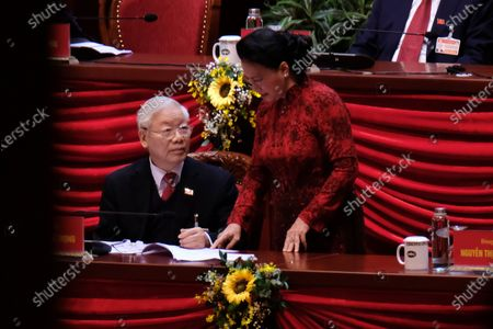 Newly re-elected Vietnam Communist Party Secretary General Nguyen Phu Trong (L) talks to Chairwoman of the National Assembly Nguyen Thi Kim Ngan (R) ahead the closing ceremony of the 13th National Congress of the Communist Party of Vietnam, at National Convention Center, in Hanoi, Vietnam, 01 February 2021.