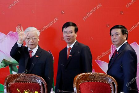 Newly re-elected Vietnam Communist Party Secretary General Nguyen Phu Trong (L), Politburo member and head of the Party Central Committee's Commission for Information and Education Vo Van Thuong (C) and Secretary of the Party Central Committee Nguyen Xuan Thang (R) arrive for a press conference after the closing ceremony of the 13th National Congress of the Communist Party of Vietnam, in Hanoi, Vietnam, 01 February 2021.
