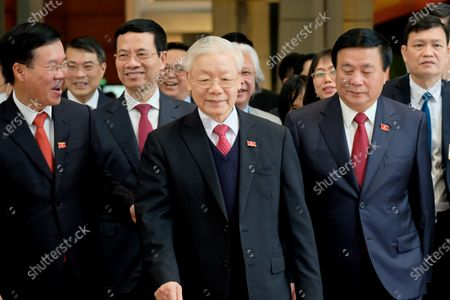 Newly re-elected Vietnam Communist Party Secretary General Nguyen Phu Trong (C) leaves after a press conference after the closing ceremony of the 13th National Congress of the Communist Party of Vietnam, in Hanoi, Vietnam, 01 February 2021.