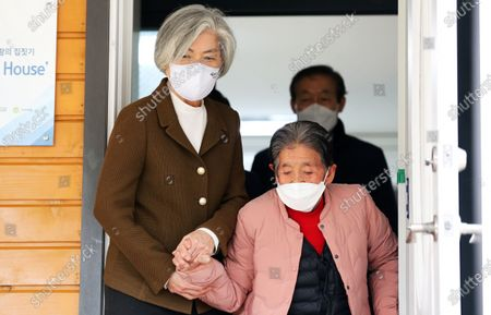 Outgoing South Korean Foreign Minister Kang Kyung-wha (L) meets with Park Pil-geun, a victim of Japan's sexual enslavement during World War II, at Park's house in the southeastern city of Pohang, South Korea, 01 February 2021.
