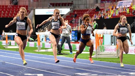 Switzerland's Ajla del Ponte, left, wins heat 1 of the women's 60 meters from Germany's Rebekka Haase, second left, and Dezerea Bryant of the United States during the ISTAF indoor athletics meeting in Dusseldorf, Germany