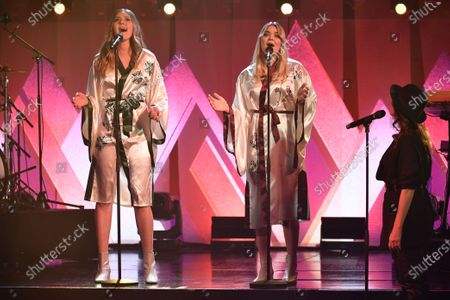 """First Aid Kit, Klara Soderberg and Johanna Soderberg, at the """"Don't Stop the Music"""" gala in Stockholm, Sweden, on January 30, 2021, organized by the Swedish Music Foundation to support everyone in the music industry who has been affected by the coronavirus pandemic."""