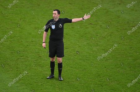 Referee Chris Kavanagh gestures during the English Premier League soccer match between Leicester City and Leeds United at the King Power Stadium in Leicester, England