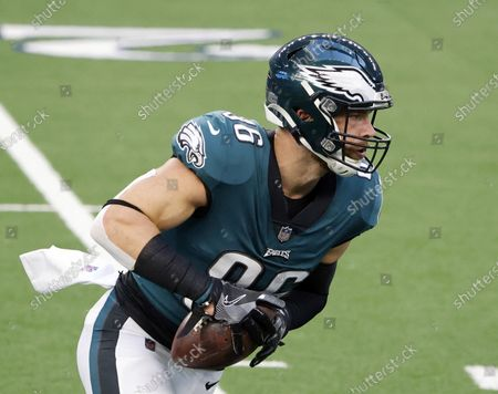Philadelphia Eagles tight end Zach Ertz catches a pass prior to an NFL football game in Arlington, Texas. Even during a pandemic with ticket sales limited and the off-the-field events drastically scaled back, an event like the Super Bowl also brings with it a heightened risk of human trafficking. Ertz is among a handful of NFL players who've joined the cause to help fight such atrocities