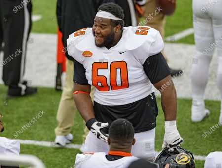 American Team offensive lineman David Moore of Grambling State (FCS) (60) walks the sideline during the NCAA Senior Bowl college football game in Mobile, Ala
