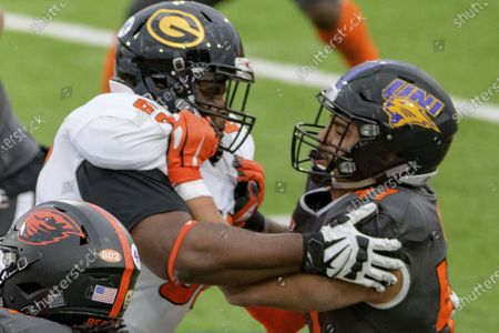 American Team offensive lineman David Moore of Grambling State (FCS) (60) blocks National Team defensive lineman Elerson Smith of Northern Iowa (FCS) (47) during the NCAA Senior Bowl college football game in Mobile, Ala