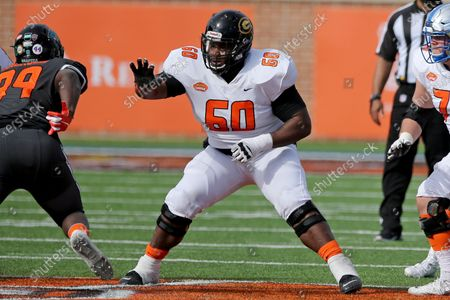 American Team offensive lineman David Moore of Grambling State (FCS) (60) in pass protection during the first half of the NCAA college football Senior Bowl in Mobile, Ala