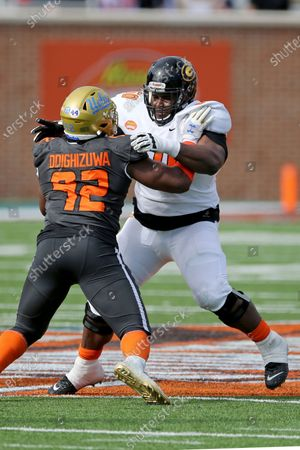 American Team offensive lineman David Moore of Grambling State (FCS) (60) blocks National Team offensive lineman Robert Hainsey of Notre Dame (72) during the first half of the NCAA college football Senior Bowl in Mobile, Ala