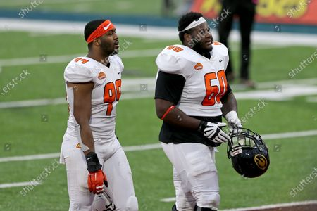 American Team William Bradley-King of Baylor (99) and offensive lineman David Moore of Grambling State (FCS) (60) walk off the field after the NCAA college football Senior Bowl in Mobile, Ala