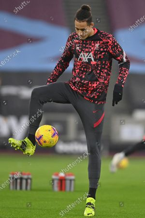 Liverpool's Rhys Williams warms up ahead of the English Premier League match between West Ham and Liverpool at the the London Stadium in London