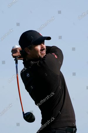 Adam Scott, of Australia, hits from the second tee on the South Course during the final round of the Farmers Insurance Open golf tournament at Torrey Pines, in San Diego