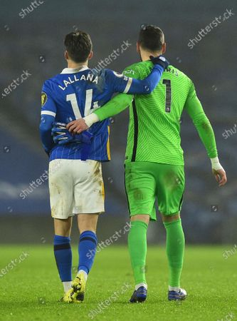 Brighton's Adam Lallana, left and Tottenham's goalkeeper Hugo Lloris walk off the pitch at the end of an English Premier League soccer match between Brighton and Tottenham Hotspur at the Amex stadium in Brighton, England