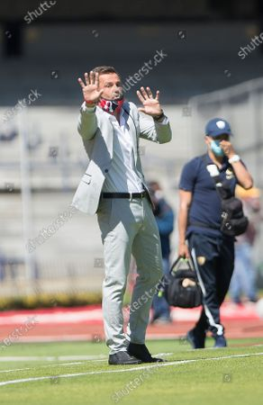Stock Image of Atlas' coach Diego Cocca gestures during a Mexico soccer league match against Pumas in Mexico City