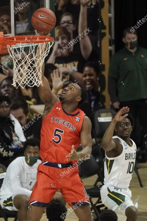 Auburn's Chris Moore (5) shoots past Baylor's Adam Flagler (10) during the first half of an NCAA college basketball game in Waco, Texas
