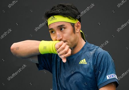 Stock Picture of Japan's Yasutaka Uchiyama wipes the sweat from his face during his match against Slovenia's Aljaz Bedene at a tuneup tournament ahead of the Australian Open tennis championships in Melbourne, Australia
