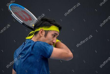 Stock Photo of Japan's Yasutaka Uchiyama reacts during his match against Slovenia's Aljaz Bedene during a tuneup tournament ahead of the Australian Open tennis championships in Melbourne, Australia