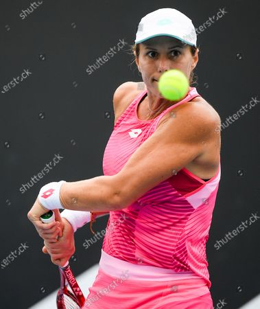 Stock Image of United States' Varvara Lepchenko makes a backhand return to Japan's Mayo Hibi during a tuneup tournament ahead of the Australian Open tennis championships in Melbourne, Australia