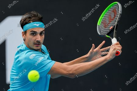 Stock Image of Italy's Lorenzo Sonego makes a backhand return to Australia's Jason Kubler during a tuneup tournament ahead of the Australian Open tennis championships in Melbourne, Australia