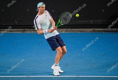 Stock Photo of Italy's Andreas Seppi makes a backhand return to compatriot Salvatore Caruso during a tuneup tournament ahead of the Australian Open tennis championships in Melbourne, Australia
