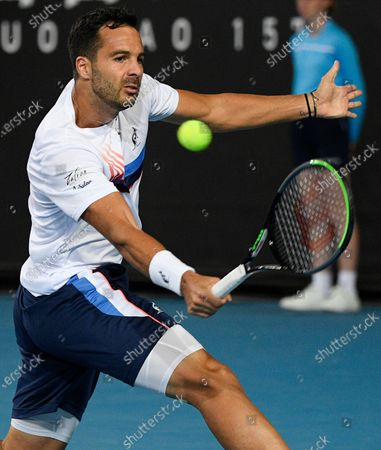 Stock Image of Salvatore Caruso makes a backhand return to compatriot Italy's Andreas Seppi during a tuneup tournament ahead of the Australian Open tennis championships in Melbourne, Australia
