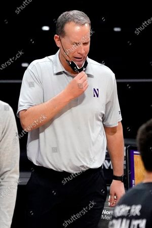 Northwestern head coach Chris Collins reacts as he watches his team during the second half of an NCAA college basketball game against Rutgers in Evanston, Ill