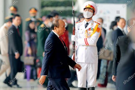 Vietnamese Prime Minister Nguyen Xuan Phuc, center, arrives at the National Convention Center to attend the closing ceremony of the 13th National Congress of the Communist Party in Hanoi, Vietnam, . Vietnam's Communist Party on Sunday reelected Nguyen to be its chief, the state Vietnam News Agency reported