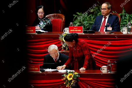 Vietnamese President and Communist Party's General Secretary Nguyen Phu Trong, left bottom, talks to National Assembly Chairwoman Nguyen Thi Kim Ngan ahead of the closing ceremony of the 13th National Congress of the Communist Party of Vietnam at National Convention Center in Hanoi, Vietnam