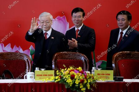 Newly re-elected Vietnam Communist Party General Secretary Nguyen Phu Trong, left, arrives for a press conference at the closing ceremony of after the 13th National Congress of the Communist Party of Vietnam, in Hanoi, Vietnam