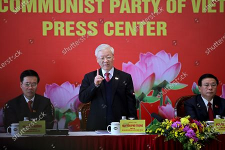 Newly re-elected Vietnam Communist Party General Secretary Nguyen Phu Trong, center, speaks during a press conference at the closing ceremony of after the 13th National Congress of the Communist Party of Vietnam, in Hanoi, Vietnam