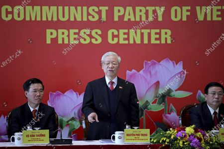 Newly re-elected Vietnam Communist Party General Secretary Nguyen Phu Trong, center, speaks during a press conference at the closing ceremony of after the 13th National Congress of the Communist Party of Vietnam, in Hanoi, Vietnam . Vietnam's Communist Party on Sunday reelected Nguyen Phu Trong to be its chief, the state Vietnam News Agency reported. His selection makes him the nation's de facto leader for a third five-year term