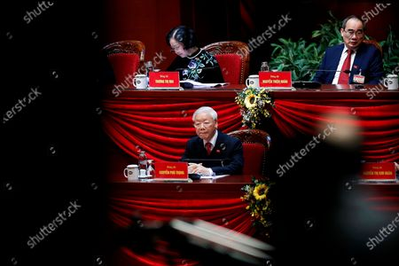 Vietnamese President and Communist Party's General Secretary Nguyen Phu Trong, center, attends the closing ceremony of the 13th National Congress of the Communist Party of Vietnam at National Convention Center in Hanoi, Vietnam