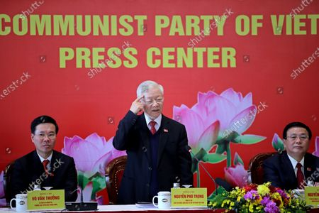 Stock Image of Newly re-elected Vietnam Communist Party General Secretary Nguyen Phu Trong, center, speaks during a press conference at the closing ceremony of after the 13th National Congress of the Communist Party of Vietnam, in Hanoi, Vietnam