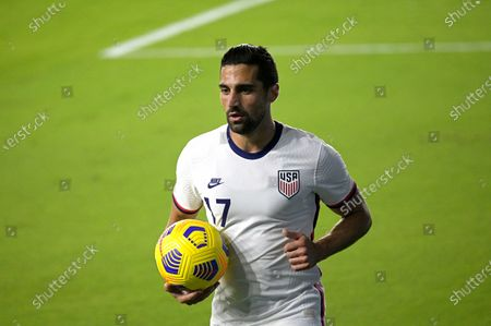 United States midfielder Sebastian Lletget (17) sets up for a corner kick during the first half of an international friendly soccer match against Trinidad and Tobago, in Orlando, Fla