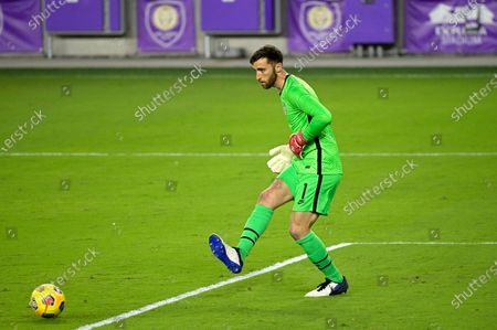 United States goalkeeper Matt Turner (1) passes the ball during the second half of an international friendly soccer match against Trinidad and Tobago, in Orlando, Fla