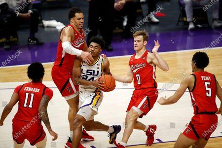 Guard Cameron Thomas (24) and Texas Tech forward Marcus Santos-Silva (14) and guard Mac McClung (0) in the second half of an NCAA college basketball game in Baton Rouge, . Texas Tech won 76-71