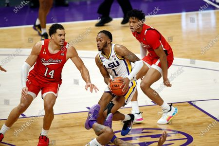 Guard Ja'Vonte Smart (1) and Texas Tech forward Marcus Santos-Silva (14) in the second half of an NCAA college basketball game in Baton Rouge, . Texas Tech won 76-71