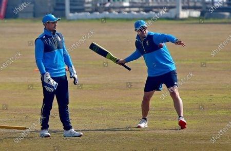 Stock Image of South Africa's head coach Mark Boucher, right, and skipper Quinton de Kock attend a practice session at the Pindi Stadium, in Rawalpindi, Pakistan, . Pakistan and South Africa will play their second cricket test match in Rawalpindi, starting on Feb. 4