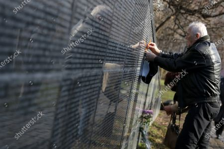 A man touches Victims of Communism Memorial monument inscribed with names of victims of the communist rule in Bulgaria. The country marks the Day of Remembrance and Respect to victims of the communist rule which ended in 1989.